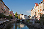 Slovenia, Ljubljana, Presernov Trg, central square, Triple Bridge, Ljubljanica River, Church of the Assumption (rose colored building), old town, Baroque architecture, Europe,