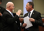 Nevada Assemblymen Randy Kirner, R-Reno, left, and Mike Sprinkle, D-Sparks, work on the Assembly floor at the Legislative Building in Carson City, Nev., on Monday, March 16, 2015. <br /> Photo by Cathleen Allison