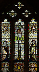 Stained glass window in church of  Saint Mary Mary and Saint Lawrence, Stratford Tony,          Wiltshire, England, UK by Kempe 1884 Crucifixion