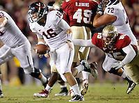 TALLAHASSEE, FL 11/19/11-FSU-UVA111911 CH-Virginia quarterback Michael Rocco scrambles away from FSU's Bjoern Werner during first half action Saturday at Doak Campbell Stadium in Tallahassee. .COLIN HACKLEY PHOTO
