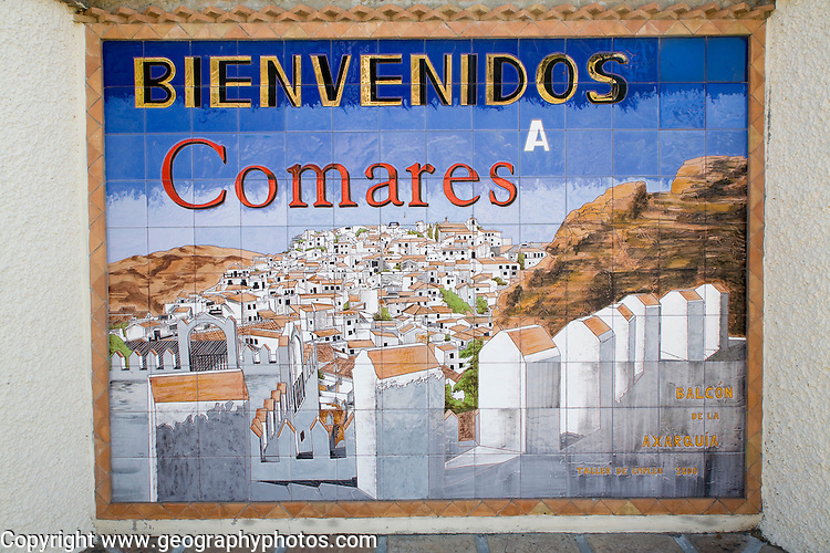Ceramic tiles welcome sign picture of the hilltop Andalusian village of Comares, Malaga province, Spain