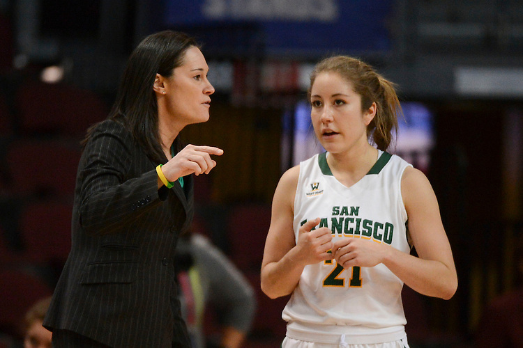 March 6, 2014; Las Vegas, NV, USA; San Francisco Lady Dons head coach Jennifer Azzi (left) talks to guard Alexa Hardick (21) against the Loyola Marymount Lions during the second half of the WCC Basketball Championships at Orleans Arena.