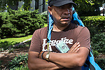 Jose Manga, from Los Angeles, California, pauses during the March on Wall Street South protest on Sunday, September 2, 2012 in Charlotte, NC.