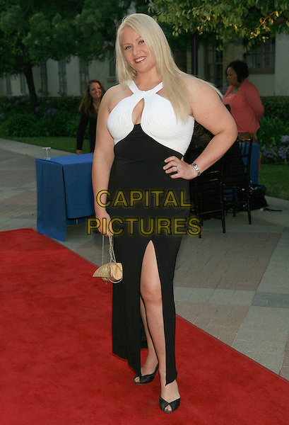 """ROBIN COLEMAN.""""St. Francis Medical Center Annual Charity Ball 2009"""" held at  Paramount Studios, Hollywood, California, USA..June 20th, 2009.full length black white dress slit split hand on hip .CAP/ADM/TC.©T. Conrad/AdMedia/Capital Pictures."""