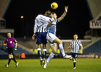 Shaun Cummings of Millwall and Dan Rowe of Wycombe Wanderers during the Checkatrade Trophy round two Southern Section match between Millwall and Wycombe Wanderers at The Den, London, England on the 7th December 2016. Photo by Liam McAvoy.