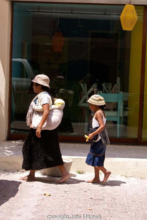 Mayan woman and her children in Playa del Carmen, Riviera Maya, Quintana Roo, Mexico.