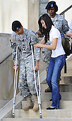 Fort Hood, TX - November 10, 2009 -- A soldier wounded in the Fort Hood shootings is assisted as he arrives for the memorial service for the 12 soldiers and one civilian killed at Fort Hood U.S Army Post near Killeen, Texas, USA 10 November 2009. Army Major Malik Nadal Hasan reportedly shot and killed 13 people, 12 soldiers and one civilian, and wounded 30 others in a rampage 05 November at the base's Soldier Readiness Center where deploying and returning soldiers undergo medical screenings.  .Credit: Tannen Maury / Pool via CNP