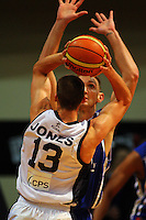 Nick Horvath tries to block a Phill Jones pass during the NBL Semifinal basketball match between the Wellington Saints and Nelson Giants at TSB Bank Arena, Wellington, New Zealand on Thursday, 12 June 2008. Photo: Dave Lintott / lintottphoto.co.nz