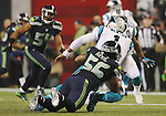 Seattle Seahawks defensive end Cliff Avril (56)  runs down Carolina Panthers quarterback Kam Chancellor (1) in the NFC Western Division Playoffs at CenturyLink Field  on January 10, 2015 in Seattle, Washington. The Seahawks beat the Panthers 31-17. ©2015. Jim Bryant Photo. All Rights Reserved.