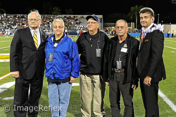 12 November 2011:  The family of former FIU student athlete and fallen U.S. Marine Corps Second Lieutenant Paul Michael Felsberg are honored by FIU President Mark B. Rosenberg and Athletic Director Pete Garcia for a major donation to FIU.  The FIU Golden Panthers defeated the Florida Atlantic University Owls, 41-7, to win the annual Shula Bowl game, at FIU Stadium in Miami, Florida.