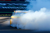 #18: Kyle Busch, Joe Gibbs Racing, Toyota Camry M&M's celebrates his win with a burnout