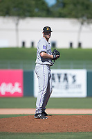 Salt River Rafters relief pitcher Mitch Horacek (32), of the Colorado Rockies organization, gets ready to deliver a pitch during an Arizona Fall League game against the Surprise Saguaros on October 9, 2018 at Surprise Stadium in Surprise, Arizona. The Rafters defeated the Saguaros 10-8. (Zachary Lucy/Four Seam Images)