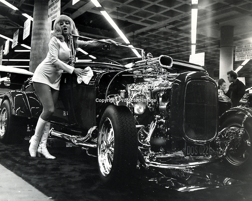 topless star Carol Doda at the Roadsterwith Voss Boretta's roadster.. (photo/RonRiesterer)
