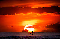A paddle boarder enjoying a memorable sunset.