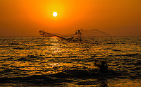 Fine Art Print, Photograph. Sunset scene of a net fishermen casting his net onto the ocean in Puerto Vallarta, Mexico.