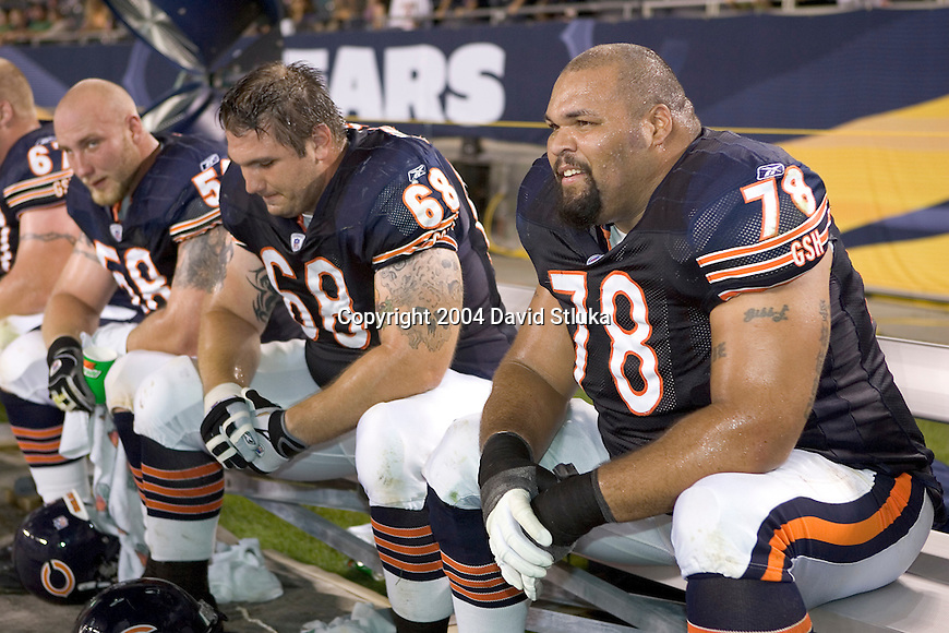 Offensive lineman (from right to left) Aaron Gibson #78, Bryan Anderson #68 and Michael Keathley #58 of the Chicago Bears rest on the bench against the New Orleans Saints at Soldier Field on August 27, 2004 in Chicago, Illinois. The Saints beat the Bears 17-13. (Photo by David Stluka)