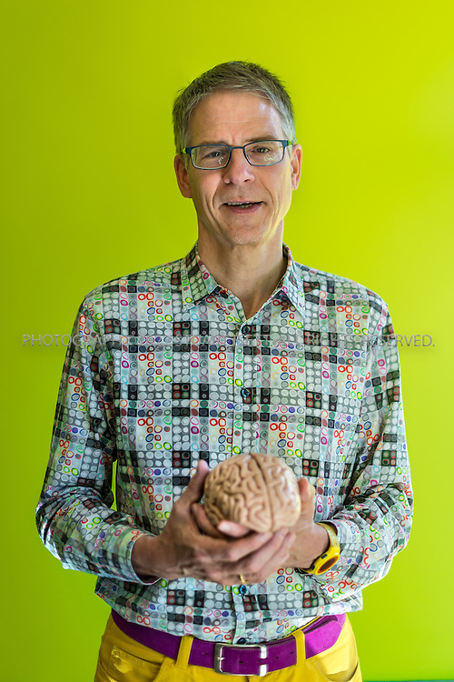 SEATTLE, USA - SEPTEMBER 16th, 2015<br /> <br /> Christof Koch, Ph.D., president and Chief Scientific Officer at the  Allen Institute for Brain Science in Seattle, WASH., USA. Here Koch poses in his office with a model brain he keeps near his desk.<br /> <br /> <br /> [SOURCE: WIKIPEDIA} The Allen Institute for Brain Science is a Seattle-based independent, nonprofit medical research organization dedicated to accelerating the understanding of how the human brain works. The Allen Institute promotes the advance of brain research by providing free data and tools to scientists worldwide with the aim of catalyzing discovery in disparate research programs and disease areas.<br /> <br /> Started with $100 million in seed money from philanthropist Paul Allen in 2003, the Institute tackles projects at the leading edge of science&mdash;far-reaching projects at the intersection of biology and technology. The resulting data create free, publicly available resources that fuel discovery for countless researchers<br /> <br /> (Photo by Stuart Isett for The Washington Post)
