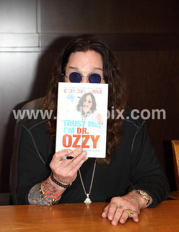 "**ALL ROUND PICTURES FROM SOLARPIX.COM**                                             **SYNDICATION RIGHTS FOR UK, AUSTRALIA, DENMARK, PORTUGAL, S. AFRICA, SPAIN & DUBAI (U.A.E) & ASIA (EXCLUDING JAPAN) ONLY**                                                                                  Caption:   Ozzy Osbourne ""Trust Me, I'm Dr. Ozzy"" Book Signing at Barnes & Noble at The Grove in Los Angeles on October 15, 2011 - Barnes & Noble at The Grove  - Los Angeles, CA, USA                                                                               This pic:  Ozzy Osbourne                                                                                            JOB REF: 14076       PHZ       DATE:  15.10.2011                                                          **MUST CREDIT SOLARPIX.COM OR DOUBLE FEE WILL BE CHARGED**                                                                      **MUST AGREE FEE BEFORE ONLINE USAGE**                               **CALL US ON: +34 952 811 768 or LOW RATE FROM UK 0844 617 7637**"