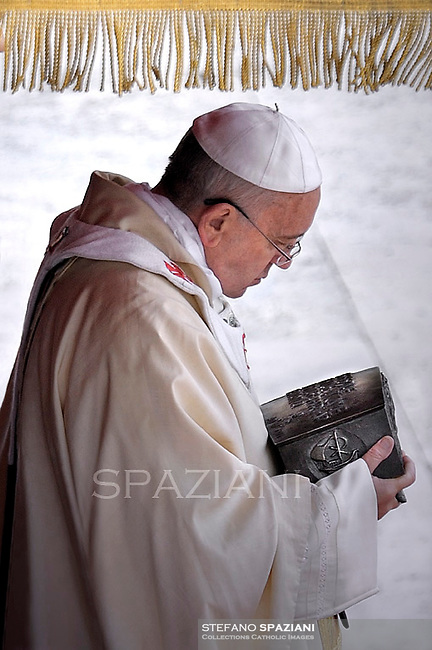 Pope Francis holds the relics of St. Peter while celebrating the Holy Mass on the occasion of the closing of the Year of Faith, in the Vatican, 24 November 2013.