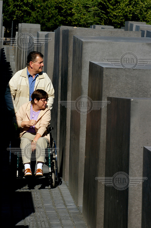 A woman in a wheelchair visits the concrete slabs of the Memorial to the Murdered Jews of Europe, a holocaust memorial opened in 2005...