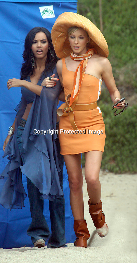 9-2-09  wed..Katie Cassidy & Jessica Lucas filming a scene for the new TV show Melrose Place in Malibu California. Katie was wearing an orange dress huge hat & a looped belt. Katie got a little hungry & ate some of the plastic covering trying to get into the fork.  They both had salad for lunch.  Katie was constantly being sprayed down with sunscreen on set. ..AbilityFilms@yahoo.com.805-427-3519.www.AbilityFilms.com.