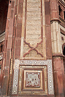 Fatehpur Sikri, Uttar Pradesh, India.  Geometric and Floral Decoration and Calligraphy Embelish a Portal of the  Buland Darwaza (Great Gate) of the Jama Masjid (Dargah Mosque), finished 1576.