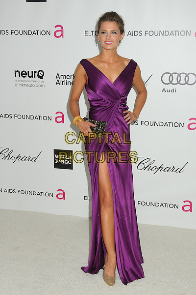 Stana Katic.20th Annual Elton John Academy Awards Viewing Party held at West Hollywood Park, West Hollywood, California, USA..February 26th, 2012.oscars full length dress wrap slit split hand on hip sleeveless clutch bag black beige shoes purple .CAP/ADM/BP.©Byron Purvis/AdMedia/Capital Pictures.