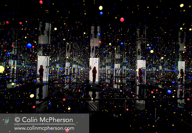 "A visitor looking at ""Gleaming Lights of the Soul"" a mixed media installation by veteran Japanese artist Yayoi Kusama, on display at Pilkington's one of the venues for the 2008 Liverpool Biennial, the UK's largest contemporary international arts festival. The Biennial commenced on September 20 and runs until the end of November. Liverpool was also 2008 European Capital of Culture."