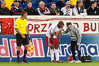 Jamison Olave (4) of the New York Red Bulls is treated for an injury along the sidelines. Sporting Kansas City defeated the New York Red Bulls 1-0 during a Major League Soccer (MLS) match at Red Bull Arena in Harrison, NJ, on April 17, 2013.