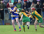 Michelle Mc Mahon of Newmarket in action against Siobhan Lafferty and Aoife Griffin of Inagh-Kilnamona during their senior county final in Clarecastle. Photograph by John Kelly.