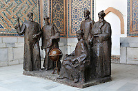 General view of statue of Ulugh Beg (1393-1449), father of scientific learning, and other Scholars in courtyard, Ulugh Beg Madrasah, 1417-20,  Registan, Samarkand, Uzbekistan, pictured on July 15, 2010, in the morning. Samarkand, a city on the Silk Road, founded as Afrosiab in the 7th century BC, is a meeting point for the world's cultures. Its most important development was in the Timurid period, 14th to 15th centuries. Picture by Manuel Cohen.
