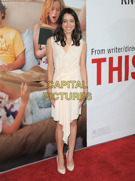 "Aubrey Plaza.""This Is 40"" Los Angeles Premiere held at Grauman's Chinese Theatre, Hollywood, California, USA..December 12th, 2012.full length dress white cream sleeveless wrap .CAP/DVS.©DVS/Capital Pictures."