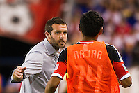 DC United head coach Ben Olsen talks with Andy Najar (14). The New York Red Bulls defeated DC United 3-2 during a Major League Soccer (MLS) match at Red Bull Arena in Harrison, NJ, on June 24, 2012.