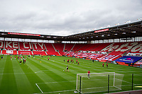 4th July 2020; Bet365 Stadium, Stoke, Staffordshire, England; English Championship Football, Stoke City versus Barnsley; Players warm up in an empty stadium