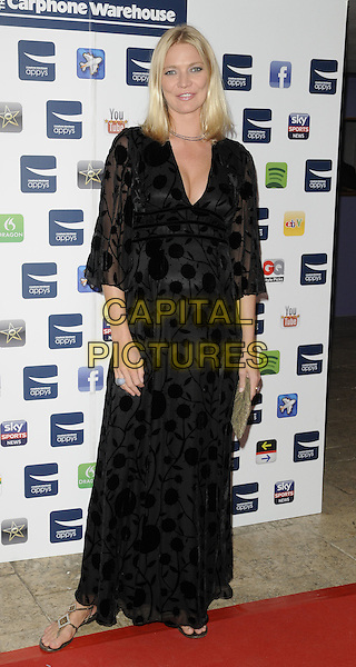 JODIE KIDD .At the Carphone Warehouse Appys Awards, Vinopolis, Stoney Street, London, England, UK, April 11th 2011..full length black long maxi dress pregnant maternity patterned kimono flats flat sandals .CAP/CAN.©Can Nguyen/Capital Pictures.