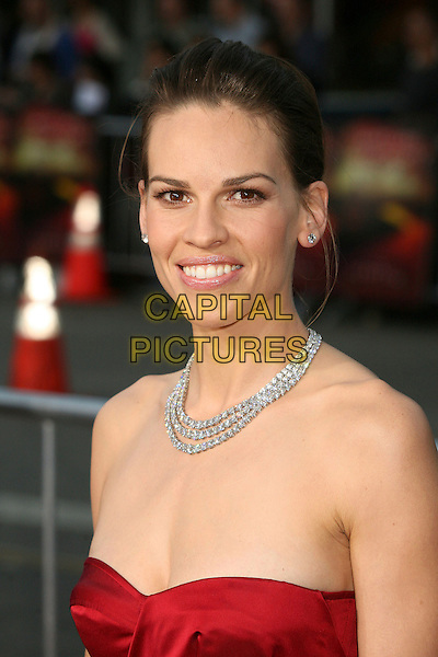 "HILARY SWANK.""The Reaping"" Los Angeles Premiere at Mann's Village Theatre, Hollywood, California, USA, 29 March 2007..portrait headshot necklace red strapless dress.CAP/ADM/BP.©Byron Purvis/AdMedia/Capital Pictures."