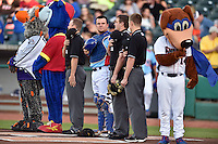 Chilly, Slugger, first base umpire Lew Williams (19), Tennessee Smokies catcher Kyle Schwarber (12), home plate umpire Blake Carnahan third base umpire Alex Ransom (1) and Homer during the National Anthem before a game between the Chattanooga Lookouts and the Tennessee Smokies on April 25, 2015 in Kodak, Tennessee. The Smokies defeated the Lookouts 16-10. (Tony Farlow/Four Seam Images)