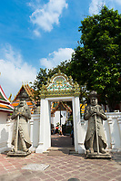 Statues of the guards in the gates of Wat Phra Chetuphon, Bangkok, Thailand