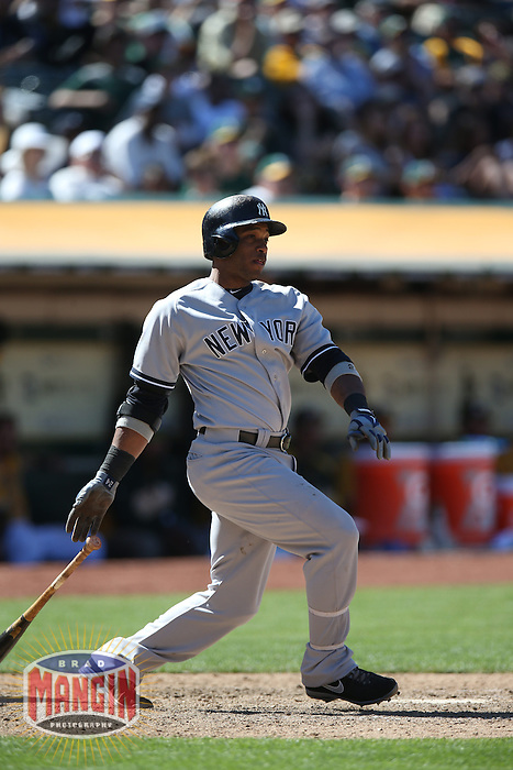 OAKLAND, CA - JUNE 13:  Robinson Cano #24 of the New York Yankees bats against the Oakland Athletics during the game at O.co Coliseum on Thursday June 13, 2013 in Oakland, California. Photo by Brad Mangin