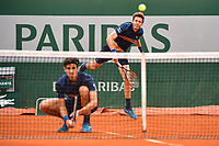 (R-L) Nicolas Mahut of France and Pierre Hughues Herbert of France during Day 11 of the French Open 2018 on June 6, 2018 in Paris, France. (Photo by Dave Winter/Icon Sport)