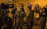 BBC outside news broadcaster explains to a Palestinian comrade how she has no authorisation to record any coverage of the Anti-imperialist counter demonstration.Chamberlain Square Birmingham 12th April 2012.