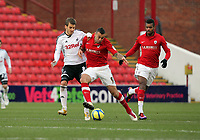 Pictured L-R: Andrea Orlandi of Swansea challenging Craig Davies of Barnsley. Saturday 07 January 2012<br /> Re: FA Cup football Barnsley FC v Swansea City FC at the Oakwell Stadium, south Yorkshire.