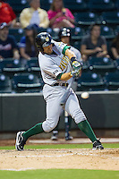 Daniel Carroll (19) of the Lynchburg Hillcats makes contact with the baseball during the game against the Winston-Salem Dash at BB&T Ballpark on August 13, 2014 in Winston-Salem, North Carolina.  The Hillcats defeated the Dash 4-3.   (Brian Westerholt/Four Seam Images)