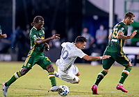 13th July 2020, Orlando, Florida, USA;  Los Angeles Galaxy forward Cristian Pavon (10) is fouled during the MLS Is Back Tournament between the LA Galaxy versus Portland Timbers on July 13, 2020 at the ESPN Wide World of Sports, Orlando FL.