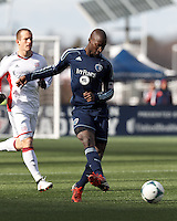 Sporting Kansas City defender Ike Opara (3) passes back to goalkeeper.  In a Major League Soccer (MLS) match, Sporting Kansas City (blue) tied the New England Revolution (white), 0-0, at Gillette Stadium on March 23, 2013.