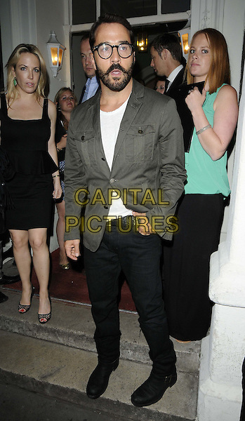 Jeremy Piven.The Omega House - Brazil Night themed party, House of St Barnabas, Greek St., London, England..August 10th, 2012.full length grey gray suit jacket white top black jeans denim glasses beard facial hair .CAP/CAN.©Can Nguyen/Capital Pictures.