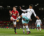 Phil Jones of Manchester United tussles with Pedro Mba Obiang of West Ham United during the Premier League match at the Old Trafford Stadium, Manchester. Picture date: November 27th, 2016. Pic Simon Bellis/Sportimage