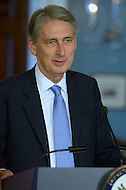 Washington, DC - October 8, 2014: U.K. foreign Secretary Philip Hammond discusses the U.S. and U.K. response to ISIL and Ebola during a joint press availability with U.S. Secretary of State John Kerry in the Treaty Room at the Department of State, October 8, 2014.   (Photo by Don Baxter/Media Images International)