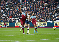 23rd November 2019; London Stadium, London, England; English Premier League Football, West Ham United versus Tottenham Hotspur; Harry Kane of Tottenham Hotspur heads the ball past Angelo Ogbonna of West Ham United to score his sides 3rd goal in the 50th minute to make it 0-3 - Strictly Editorial Use Only. No use with unauthorized audio, video, data, fixture lists, club/league logos or 'live' services. Online in-match use limited to 120 images, no video emulation. No use in betting, games or single club/league/player publications