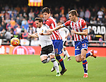 Valencia CF's  Pablo Piatti  and Sporting de Gijon's  Jorge Mere and Vranjes during La Liga match. January 31, 2016. (ALTERPHOTOS/Javier Comos)